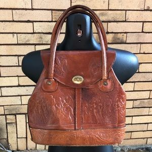 Vintage hand tooled brown leather bag